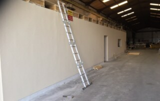 Finished ICF wall skimmed and painted Insulated Concrete Form wall inside a warehouse